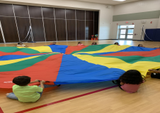 We are having a blast with the parachute this week!