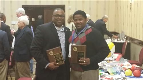 Hall of Fame Coach Leroy Burrell and Coach of the Year Award recipient Coach Ervin . This award was given by The Texas High S