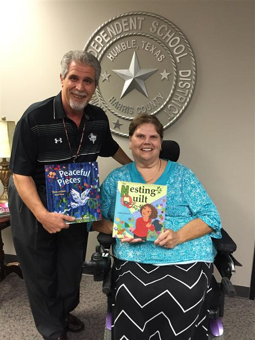 Dr. Sconzo accepts book donations from Kingwood Area Quilt Guild President Brenda Howard.