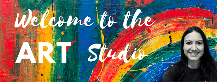 Welcome to the Art Studio sign with a picture of Mrs. Pugh on a rainbow background.  It says, Welcome to the Art Studio.